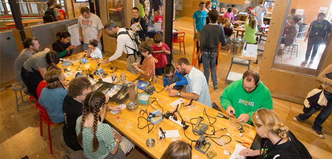 Families and students at a Maker's Fair event