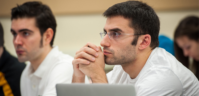 A student sitting in class looking ahead