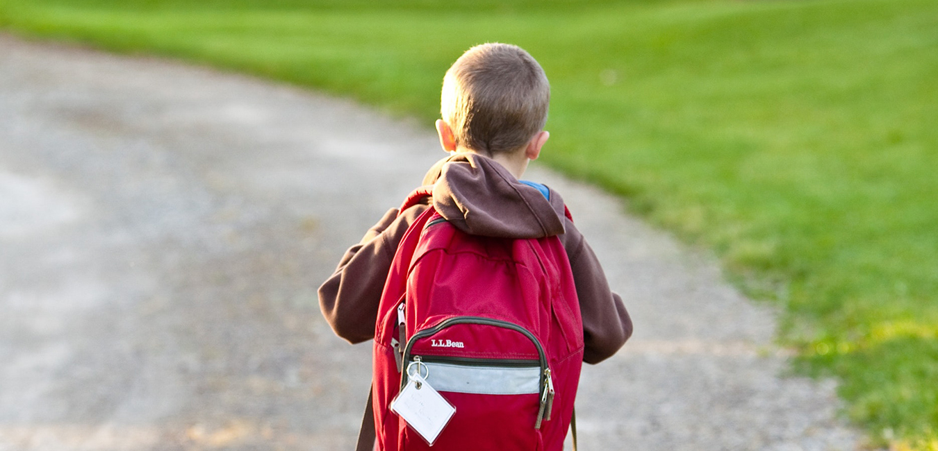 Boy walking with a backpack