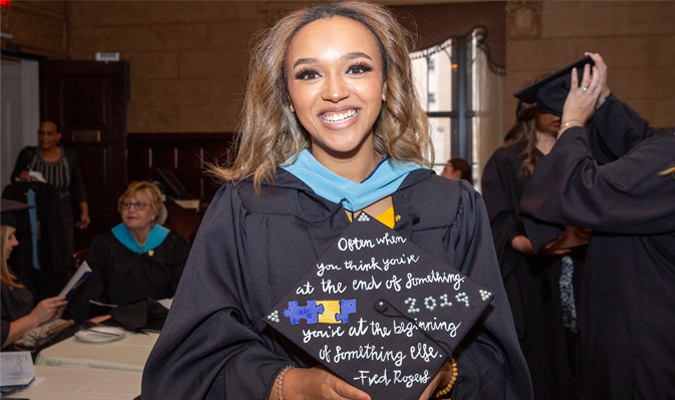 A graduating female student from the School of Education