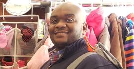 A man smiles into the camera