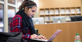 A student works on her laptop