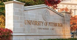 A stone sign marks the University of Pittsburgh campus